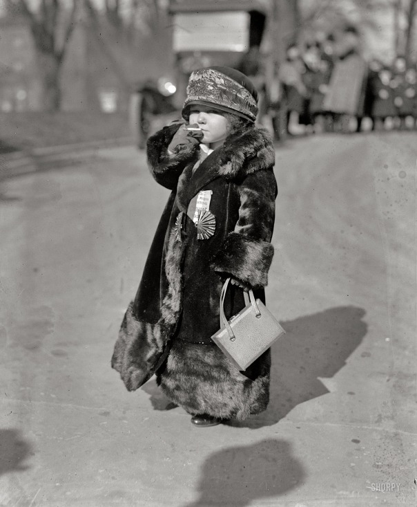 "January 23, 1924. Washington, D.C. ""Midget."" News item, Jan. 20: ""The first organized touring Coolidge Marching Club to work for the nomination of the president comes to Washington Sunday morning. It is composed of 25 European midgets, headed by I.S. Rose, New Englander and impresario. The midgets wear buttons and ribbons on which is inscribed 'Coolidge 1925."